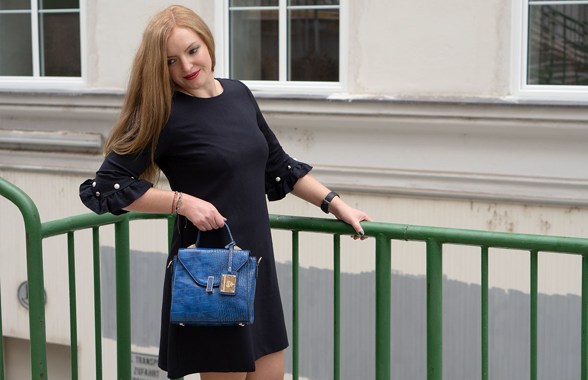 10 Gründe warum ich es liebe in Wien zu leben outfit hse24 mantel über schulter ärmel